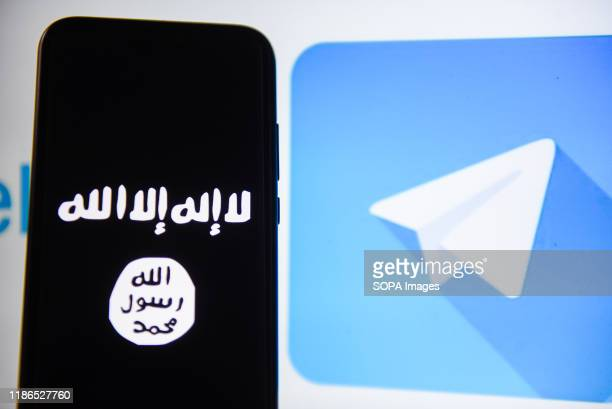 In this photo illustration a Telegram and Islamic State logos are seen displayed on a smartphone.