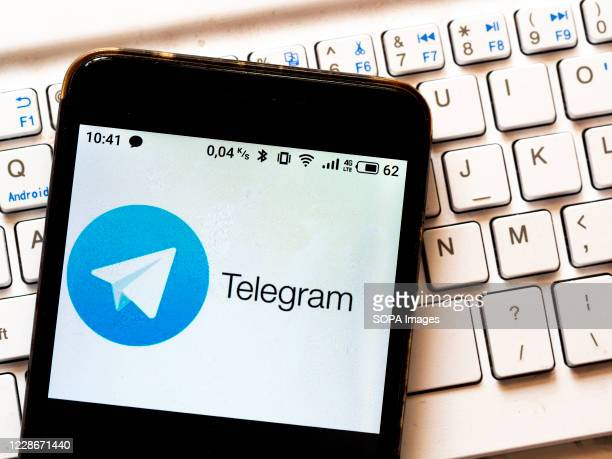 In this photo illustration a Telegram logo is seen displayed on a smartphone.