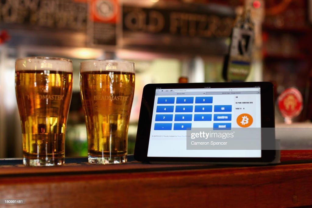 In this photo illustration, a terminal to accept payments using bitcoins is displayed on the bar at the Old Fitzroy pub on September 19, 2013 in Sydney, Australia. The Old Fitzroy pub in Sydney's eastern suburbs will accept the digital currency, Bitcoin, as of Next Sunday. Using a smartphone and a QR code scanning application customers will be able to purchase beer and menu items at the bar. The Old Fitzroy is the first Australian pub to accept Bitcoin payment.
