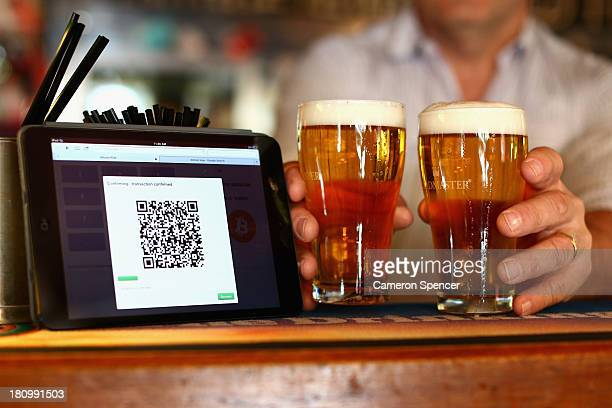 In this photo illustration a terminal to accept payments using bitcoins is displayed on the bar at the Old Fitzroy pub on September 19 2013 in Sydney...