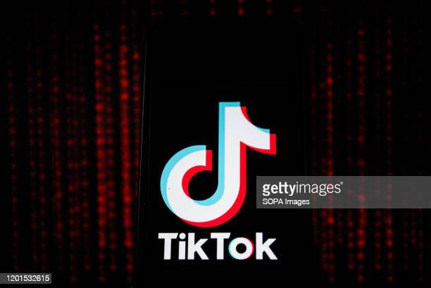 In this photo illustration a Tik Tok logo seen displayed on a smartphone.