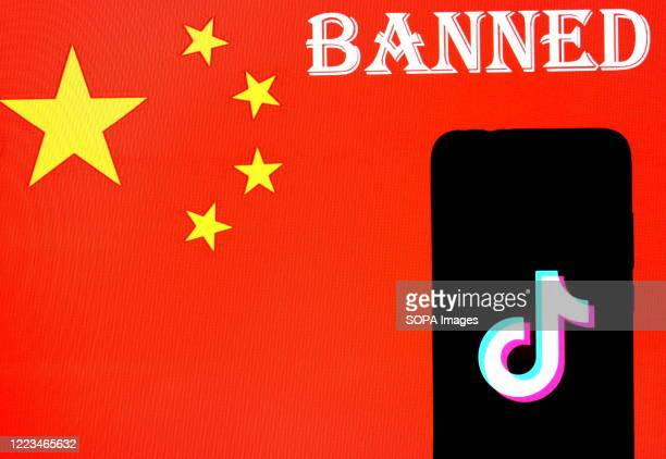 In this photo illustration a Tiktok application logo seen displayed with a background of the Chinese Flag. Indian Government issued an order on 29th...