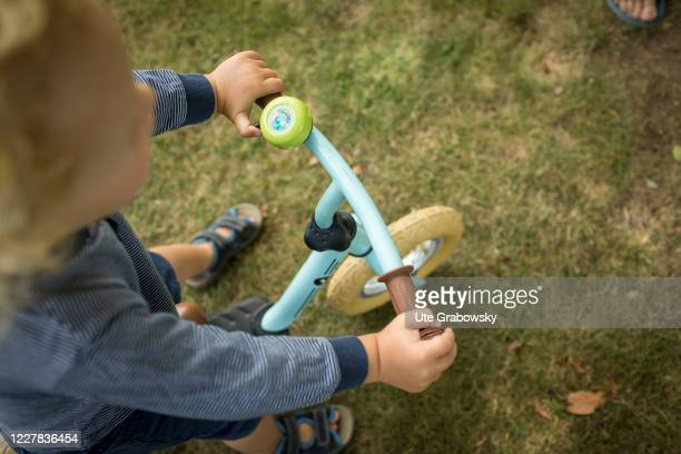 In this photo illustration a toddler is riding a one wheel bicycle, on July 27, 2020 in Bonn, Germany.