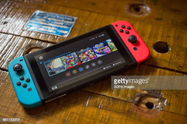 In this photo illustration a turned on Nintendo Switch with 2 JoyCon attached on it The Kyoto based video game company Nintendo ended its comeback...