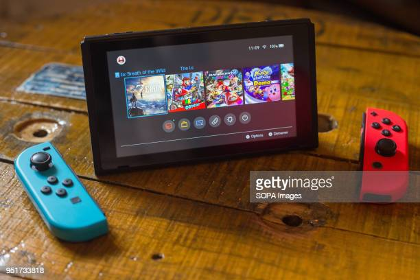 In this photo illustration a turned on Nintendo Switch with 2 JoyCon in front of it The Kyoto based video game company Nintendo ended its comeback...
