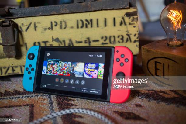 In this photo illustration, a turned on Nintendo Switch with two Joy-Con.
