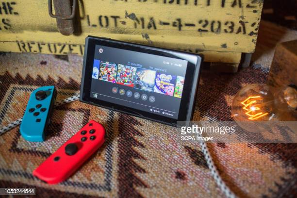 In this photo illustration a turned on Nintendo Switch with two JoyCon