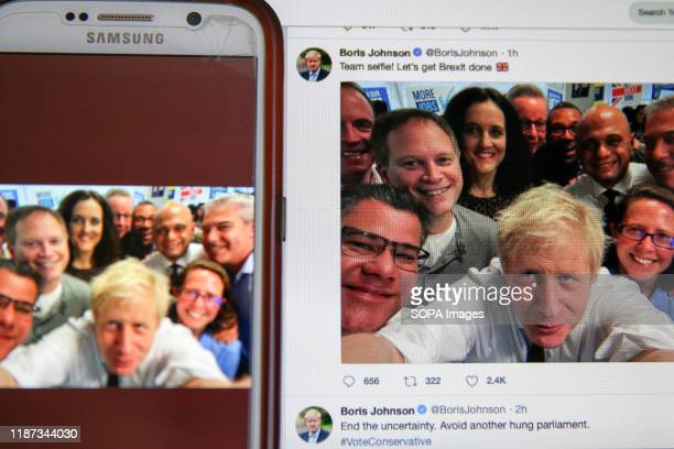 In this photo illustration a tweet by Boris Johnson Prime Minister of the United Kingdom and the leader of the Conservative Party showing him taking...