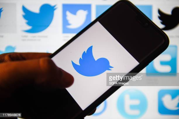 In this photo illustration a Twitter logo displayed on a smartphone.