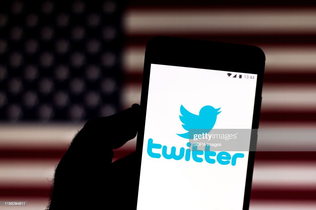 In this photo illustration a Twitter logo seen displayed on... : News Photo