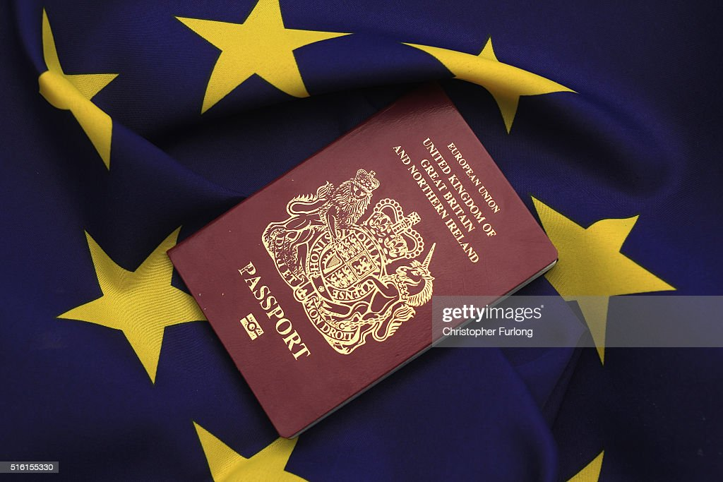 In this photo illustration, a United Kingdom EU passport sits on a European Union flag on March 17, 2016 in Knutsford, United Kingdom. The United Kingdom will hold a referendum on June 23, 2016 to decide whether or not to remain a member of the European Union (EU), an economic and political partnership involving 28 European countries which allows members to trade together in a single market and free movement across its borders for citizens.