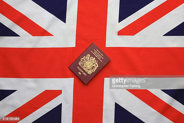 In this photo illustration a United Kingdom EU passport sits on a Union flag on March 17 2016 in Knutsford United Kingdom The United Kingdom will...