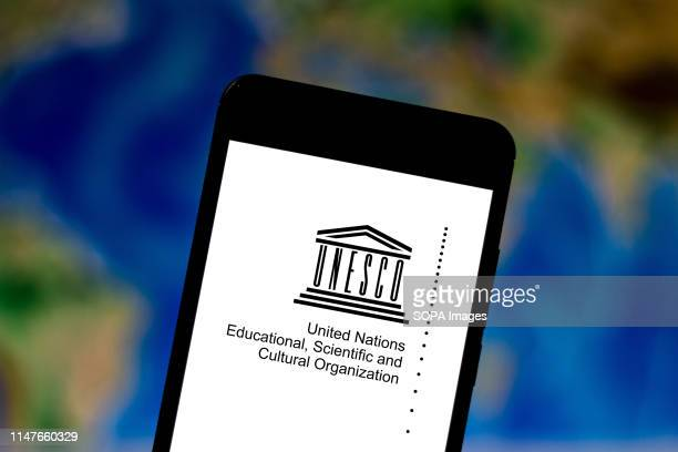 In this photo illustration a United Nations Educational Scientific and Cultural Organization logo seen displayed on a smartphone