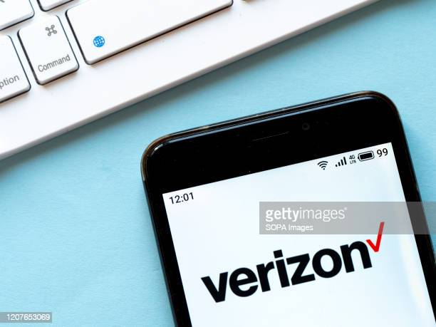In this photo illustration a Verizon logo seen displayed on a smartphone