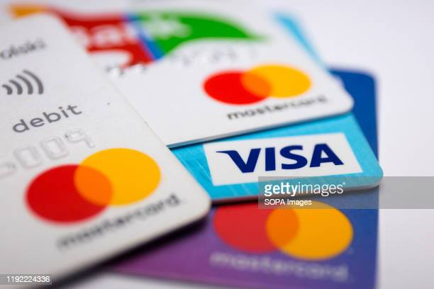 In this photo illustration a Visa credit card and Mastercard debit cards are seen displayed.