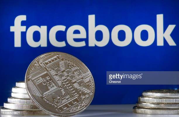 In this photo illustration a visual representation of a digital cryptocurrency coin sits on display in front of a Facebook logo on June 17 2019 in...