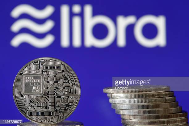 In this photo illustration a visual representation of a digital cryptocurrency coin sits on display in front of a Libra logo on June 18 2019 in Paris...