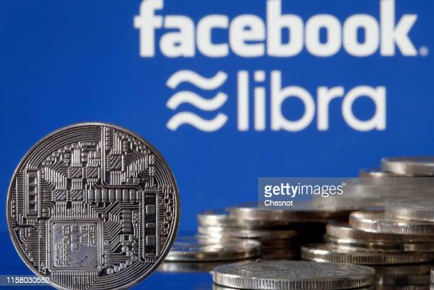In this photo illustration a visual representation of a digital cryptocurrency coin sits on display in front of Libra and Facebook logos on June 24...