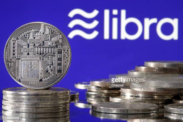 In this photo illustration a visual representation of a digital cryptocurrency coin sits on display in front of a Libra logo on June 24 2019 in Paris...