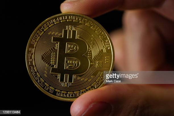 In this photo illustration, a visual representation of Bitcoin cryptocurrency is pictured on May 21, 2021 in London, England. Bitcoin is a...