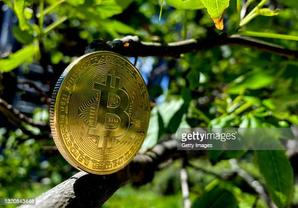 In this photo illustration, a visual representation of Bitcoin cryptocurrency is pictured on May 30, 2021 in London, England. Bitcoin is a...