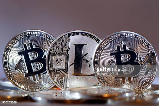 In this photo illustration a visual representation of digital cryptocurrencies Bitcoin and Litecoin are displayed on January 15 2018 in Paris France...