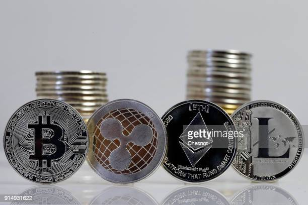 In this photo illustration a visual representation of digital cryptocurrencies Bitcoin Ripple Ethernum and Litecoin is displayed on February 6 2018...