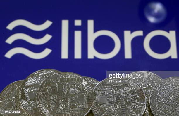 In this photo illustration a visual representation of digital cryptocurrency coins sit on display in front of a Libra logo on June 18 2019 in Paris...