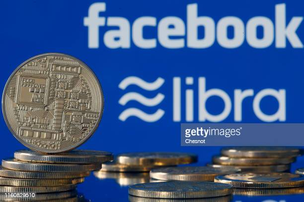 In this photo illustration a visual representation of digital cryptocurrency coins sit on display in front of Libra and Facebook logos on July 08...