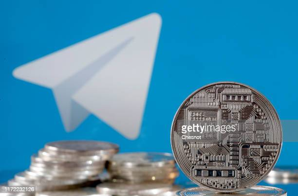 In this photo illustration, a visual representation of digital cryptocurrency coins is displayed in front of the Telegram messaging logo on September...