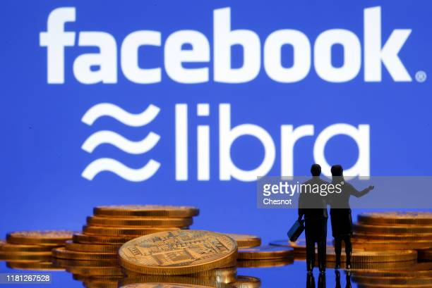 In this photo illustration a visual representation of digital cryptocurrency coins sit on display in front of Libra and Facebook logos on October 15...