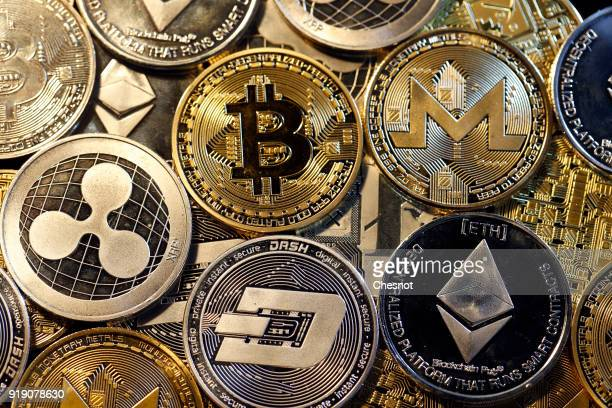 In this photo illustration a visual representation of digital cryptocurrencies Bitcoin Ripple Ethernum Dash Monero and Litecoin is displayed on...