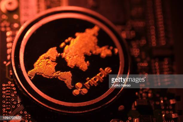 In this photo illustration, a visual representation of digital cryptocurrency Ripple is arranged on a circuit board of a hard drive on January 3,...