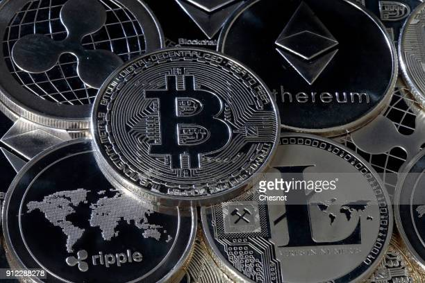 In this photo illustration a visual representation of digital cryptocurrencies Ripple Bitcoin Ethernum and Litecoin are displayed on January 30 2018...