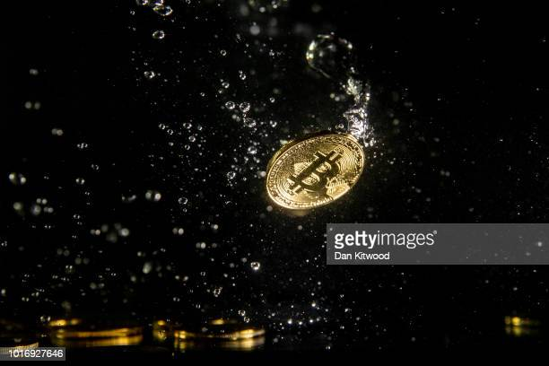 In this photo illustration a visual representation of the digital currency Bitcoin sinks into water on August 15 2018 in London England Most digital...
