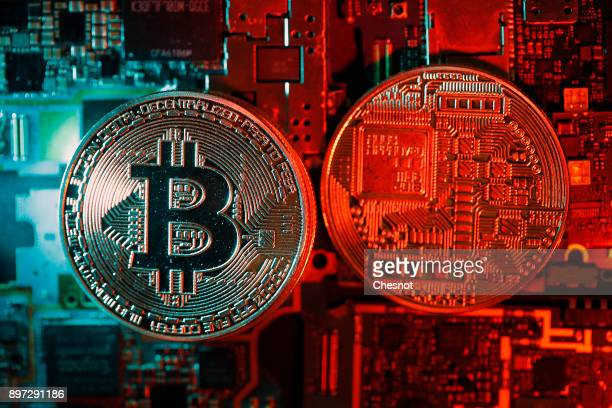 In this photo illustration a visual representation of the digital Cryptocurrency Bitcoin is displayed on December 22 2017 in Paris France The price...