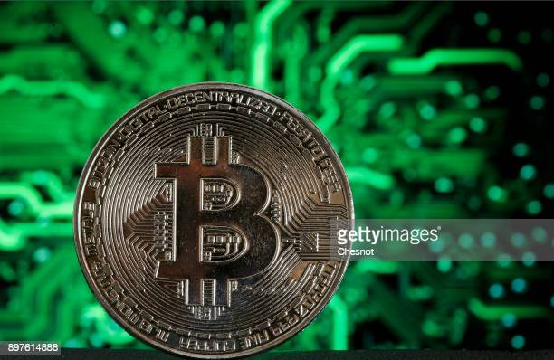 In this photo illustration a visual representation of the digital Cryptocurrency Bitcoin is displayed on December 23 2017 in Paris France The price...