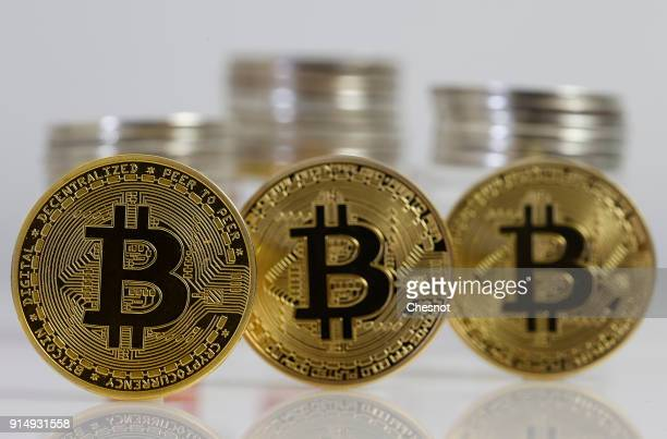 In this photo illustration a visual representation of the digital Cryptocurrency Bitcoin is displayed on February 6 2018 in Paris France The...