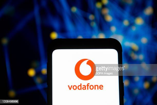 In this photo illustration a Vodafone logo seen displayed on a smartphone.