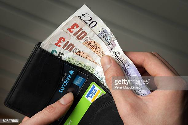 In this photo illustration a wallet containing cash and credit cards is shown on April 17 2008 in London England The United Kingdom's financial...