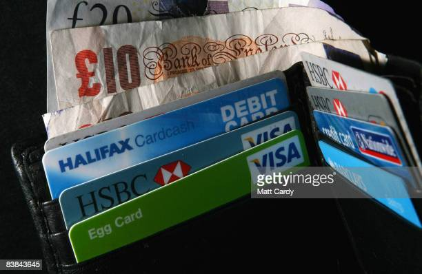In this photo illustration a wallet open to show credit cards and cash on November 27 2008 in Bristol England Many UK consumers are feeling the pinch...