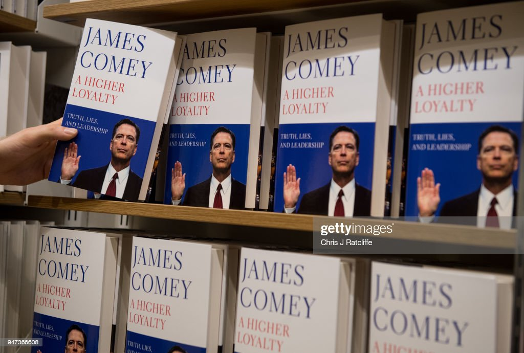 In this photo illustration a Waterstone's employee places copies of Former FBI Director James Comey's book on a shelf as it is released in the UK at Waterstone's, Piccadilly on April 17, 2018 in London, England. The former Federal Bureau of Investigations Director was fired by US President Donald Trump in 2017 and has since written his book 'A Higher Loyalty' about everything from his childhood to his time as FBI Director and his firing by the president.
