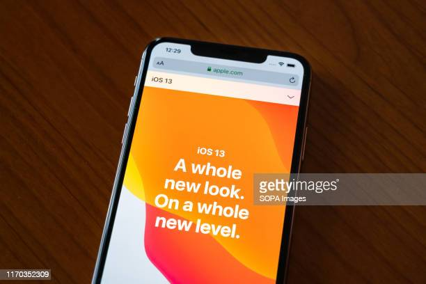 In this photo illustration a webpage of iOS 13 is displayed on the screen of an iPhone 11 Pro Max smartphone