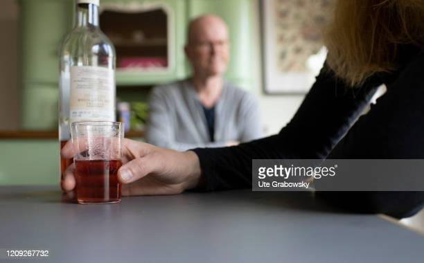 In this photo illustration a wife is drinking an alcoholic drink in front og her angry husband on April 02 2020 in Bonn Germany