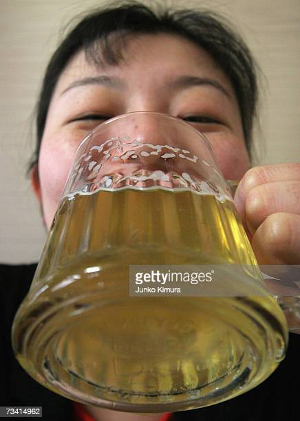 In this photo illustration a woman drinks Bilk, a beer made from milk, on February 25, 2007 in Tokyo, Japan. A liquor shop named Nakahara, on the...
