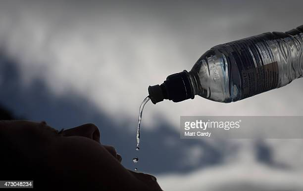 In this photo illustration a woman drinks bottled water on May 12, 2015 in Midsomer Norton, England. Water is set to be the world's best selling soft...