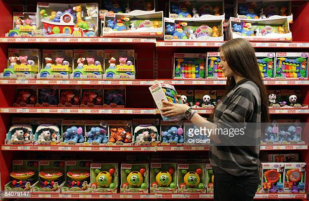 In this photo illustration a woman examines the children's toys in the Hamleys toy store on Regent Street on December 18 2008 in London England Staff...