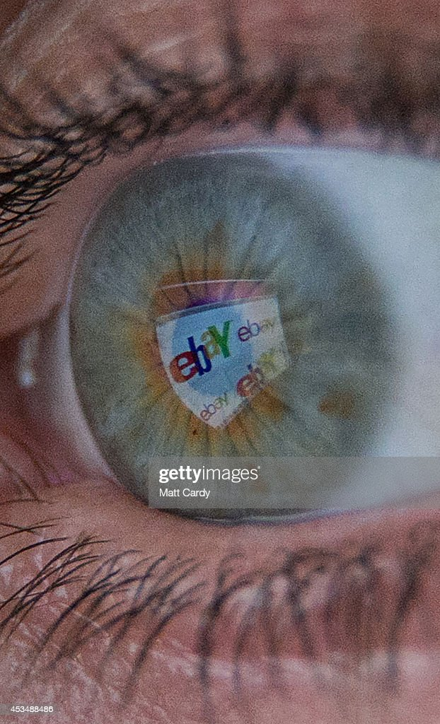 In this photo illustration a woman has the online retailer eBay logo reflected in her eye as she shops online on August 11, 2014 in Bristol, United Kingdom. This week marks the 20th anniversary of the first online sale. Since that sale - a copy of an album by the artist Sting - online retailing has grown to such an extent that it is now claimed that 95 percent of the UK population has shopped online and close to one in four deciding to shop online each week.