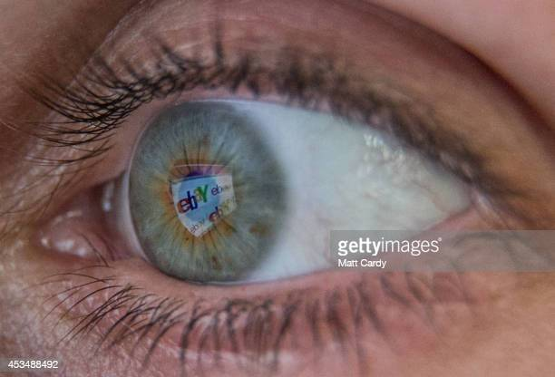 In this photo illustration a woman has the online retailer eBay logo reflected in her eye as she shops online on August 11 2014 in Bristol United...