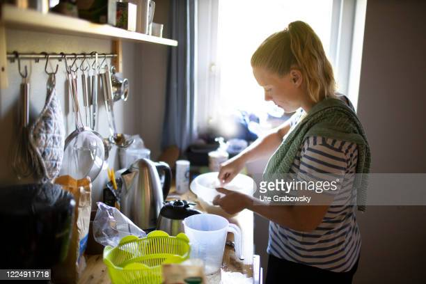 In this photo illustration a woman in kitchen is preparing a meal on June 24, 2020 in Oostkapelle, Netherlands.
